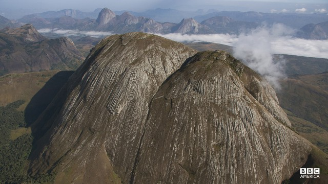 Episode 4  An aerial view of one of many granite inselbergs in Mozambique. These monuments are shrouded on the lower slopes by trees, that combined, make up the largest tract of rainforest anywhere in southern Africa. The 'Africa' crew joined only the second expedition to this area and were the first to film it from the air.