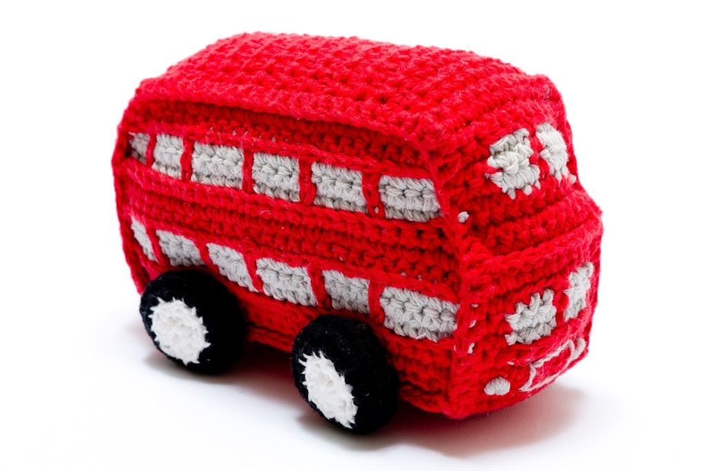 This crocheted red bus is a cuddly toy and rattle. (biff)