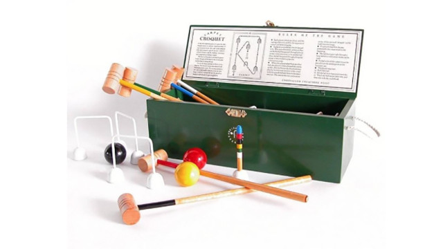 We'll work on our game with this indoor croquet set. (TheWeddingShop)
