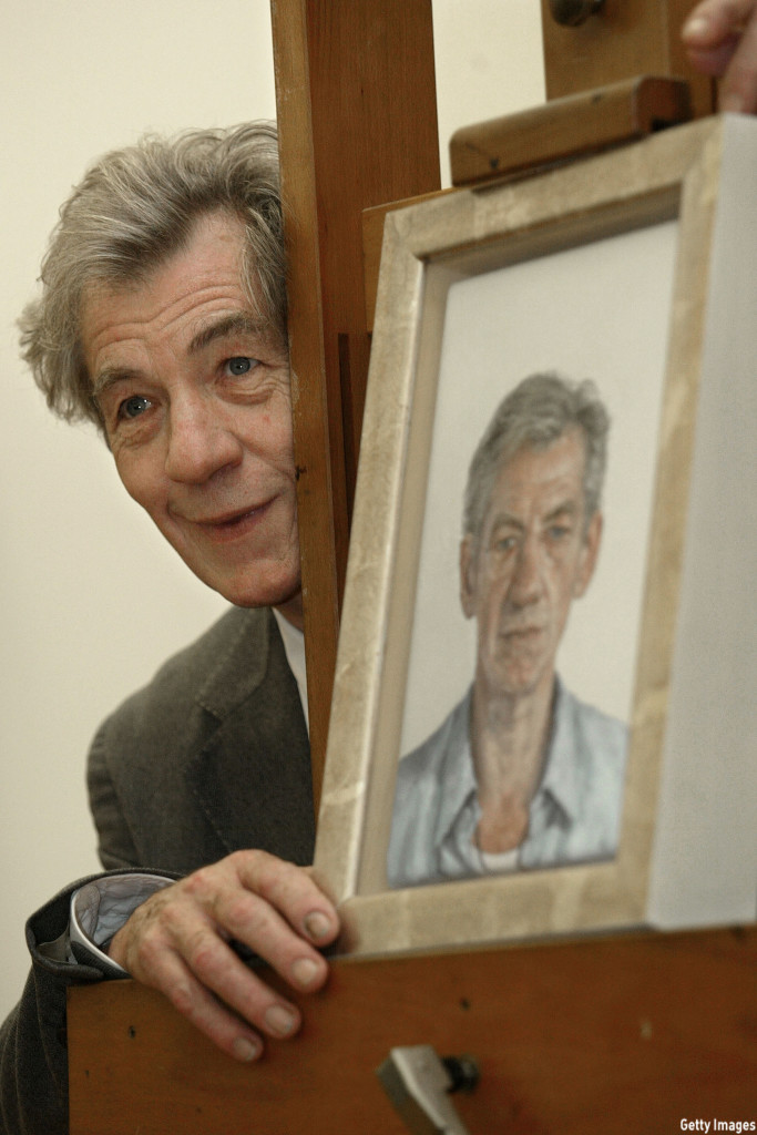 McKellen posed with a portrait of himself during the unveiling of the painting by artist Clive Smith at the National Portrait Gallery in London in 2002. (Sion Touhig/Getty Images)