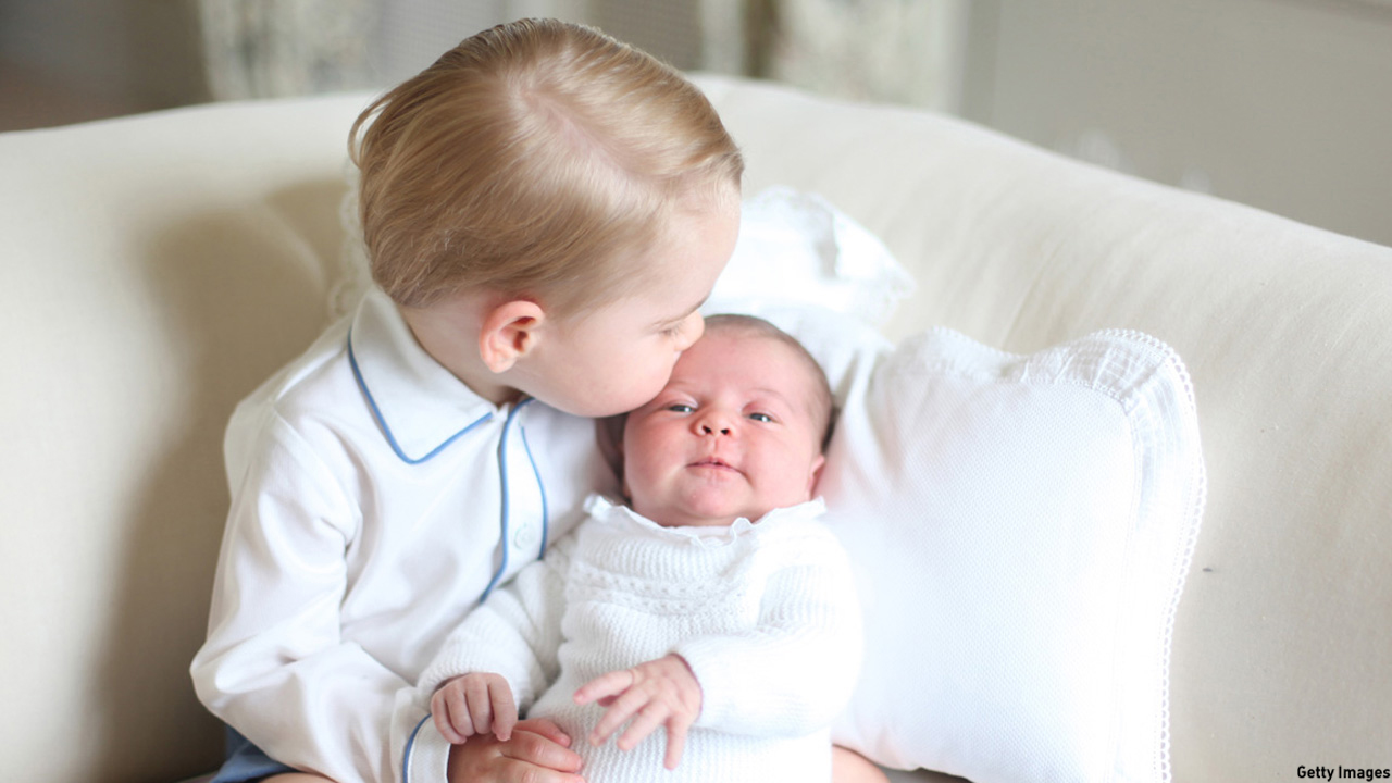 Prince George welcomed his baby sister Princess Charlotte with a kiss on her forehead in May 2015. (HRH The Duchess of Cambridge via Getty Images)