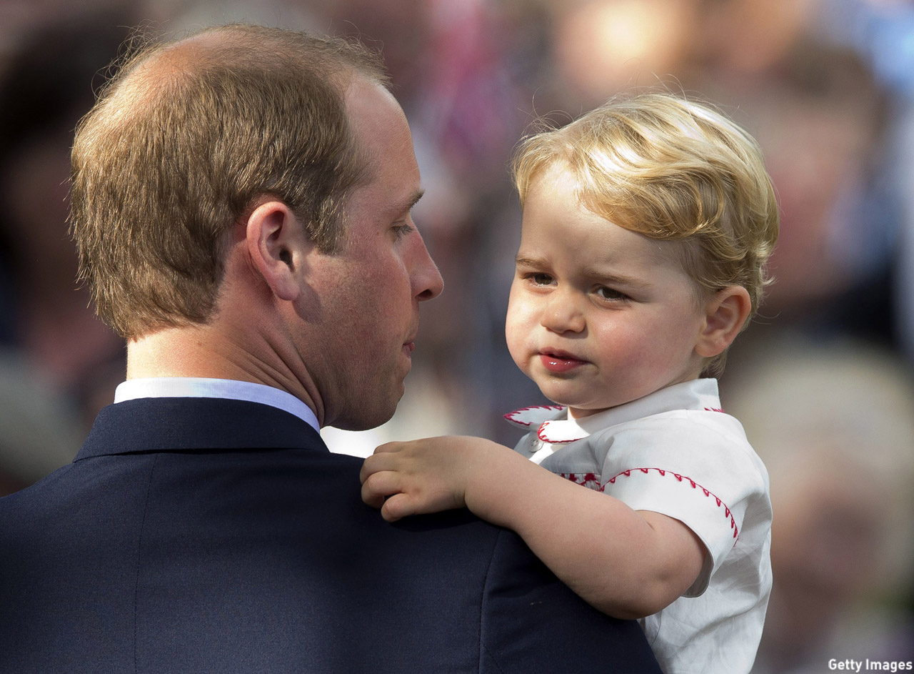 Prince William gave his son a lift so Prince George could get a better view at Princess Charlotte's christening in July 2015. (Matt Dunham - WPA Pool/Getty Images)