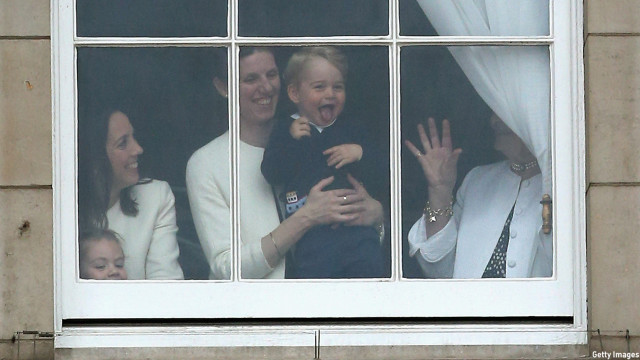 The excited little boy was seen in a window of Buckingham Palace during the Trooping of the Colour in June 2015. (Chris Jackson/Getty Images)
