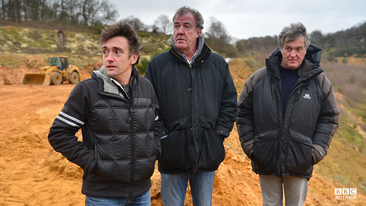 Richard Hammond, Jeremy Clarkson and James May watch a challenge at a quarry.