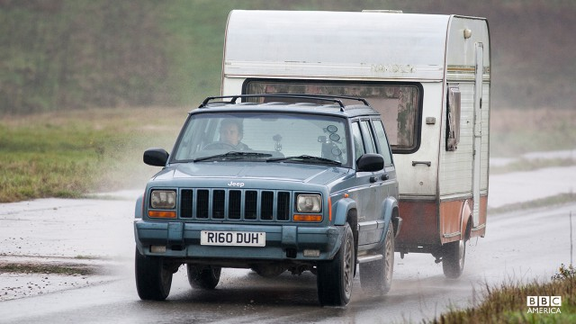 Richard Hammond driving a Jeep Cherokee in a Caravan-Towing Challenge.
