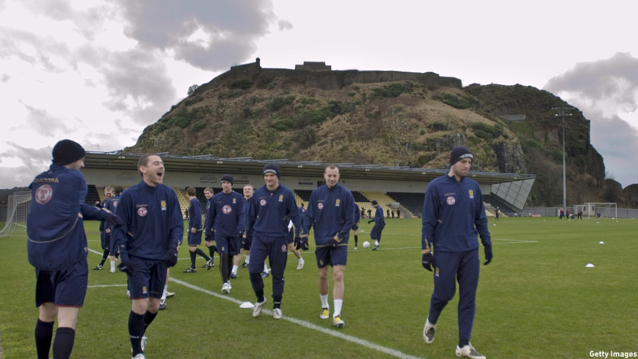 DUMBARTON, SCOTLAND - FEBRUARY 4:  The Scotland Squad warm up during George Burley's first training session as Scotland Manager at Dumbarton FC, with Dumbarton Rock in the background, on February 4, 2008 in Dumbarton, Scotland.  (Photo Robert Paterson/Getty Images)