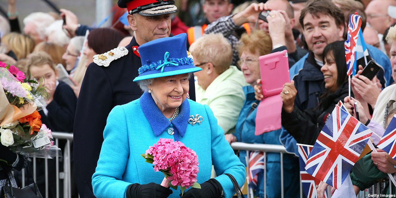 Queen Elizabeth II arrives to greets well-wishers before she unveils a commemorative plaque at Newtongrange railway station on board the steam locomotive 'Union of South Africa' on the day she becomes Britain's longest reigning monarch on September 09, 2015 in Newtongrange, Scotland. Today, Her Majesty Queen Elizabeth II becomes the longest reigning monarch in British history overtaking her great-great grandmother Queen Victoria's record by one day. The Queen has reigned for a total of 63 years and 217 days. Accompanied by her husband and Scotland's First Minister Nicola Sturgeon she will officially open the new Scottish Border's Railway which runs from the capital to Tweedbank.  (Photo: Andrew Milligan - WPA Pool/Getty Images)