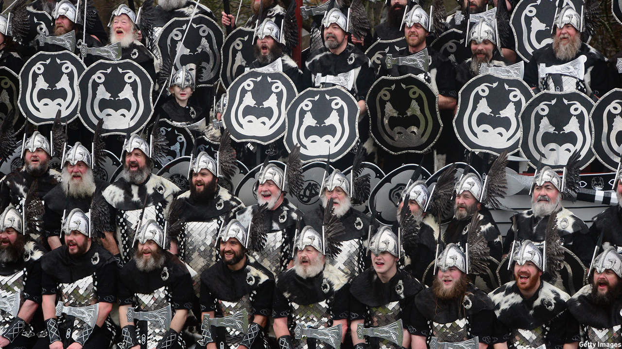 "Locals in Lerwick, Scotland, the main port of the Shetland Islands, dress up as Vikings for the traditional festival fire known as ""Up Helly Aa."" (Jeff J. Mitchell/Getty Images)"