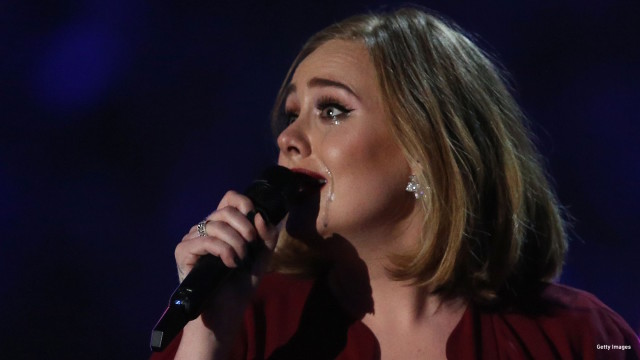Tears run down the face of British singer Adele as she reacts after receiving the Global Success award during the BRIT Awards 2016 in London on February 24, 2016.