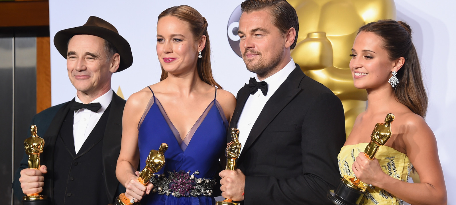 Actor Mark Rylance, winner of Best Supporting Actor for 'Bridge of Spies,' actress Brie Larson, winner of Best Actress for 'Room,' actor Leonardo DiCaprio, winner of Best Actor for 'The Revenant,' and actress Alicia Vikander, winner of Best Supporting Actress for 'The Danish Girl,' pose in the press room during the 88th Annual Academy Awards at Loews Hollywood Hotel on February 28, 2016 in Hollywood, California.