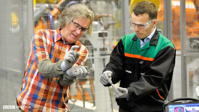 Presenter James May with contributor Tom Bradford in the 'Body in White' section of the factory.