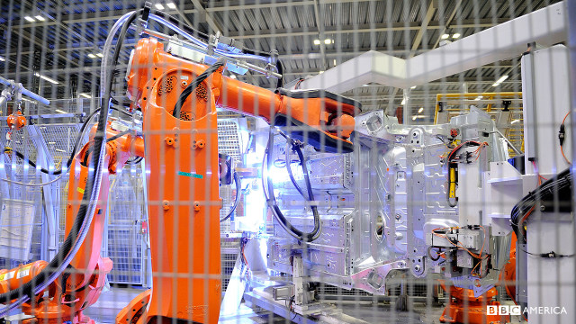 Welding robots in the 'Body in White' section of the factory.