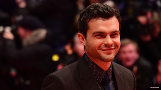 "US actor Alden Ehrenreich poses for photographers as he arrives on the red carpet for the film ""Hail, Caesar!"" screening as opening film of the 66th Berlinale Film Festival in Berlin on February 11, 2016. Eighteen pictures will vie for the Golden Bear top prize at the event which runs from February 11 to 21, 2016."