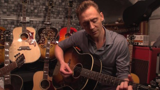 Tom Hiddleston plays guitar