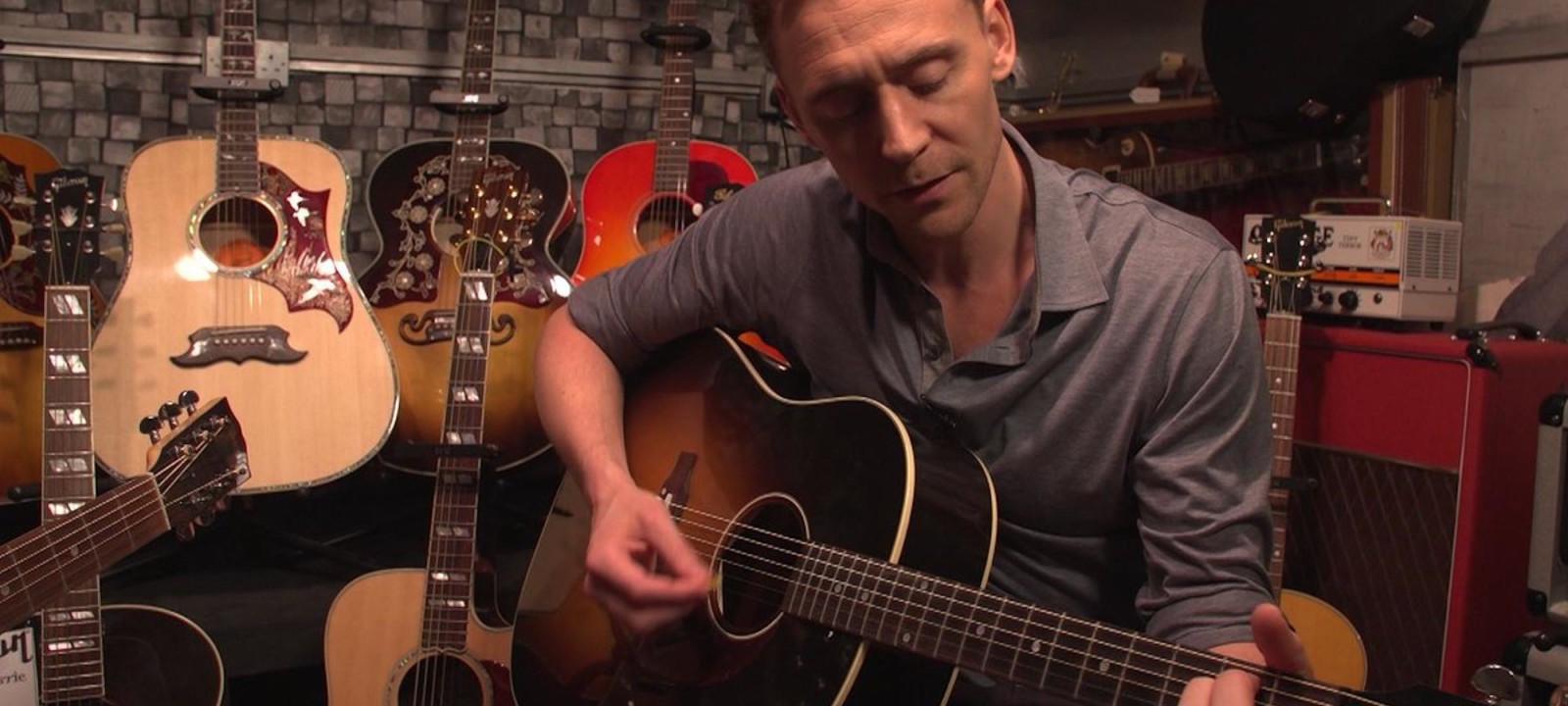 Tom Hiddleston plays guitar