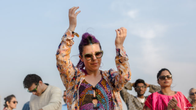 In this photograph taken on December 20, 2015, festival-goers dance as Indian act Delhi Sultanate (BFR) performs during the Magnetic Fields music festival in Alsisar in India's western state of Rajasthan. The festival, held in the 17th century Alsisar Mahal, aims to fuse art and music, showcasing local and international contemporary acts over three days. AFP PHOTO / Rebecca Conway / AFP / Rebecca Conway