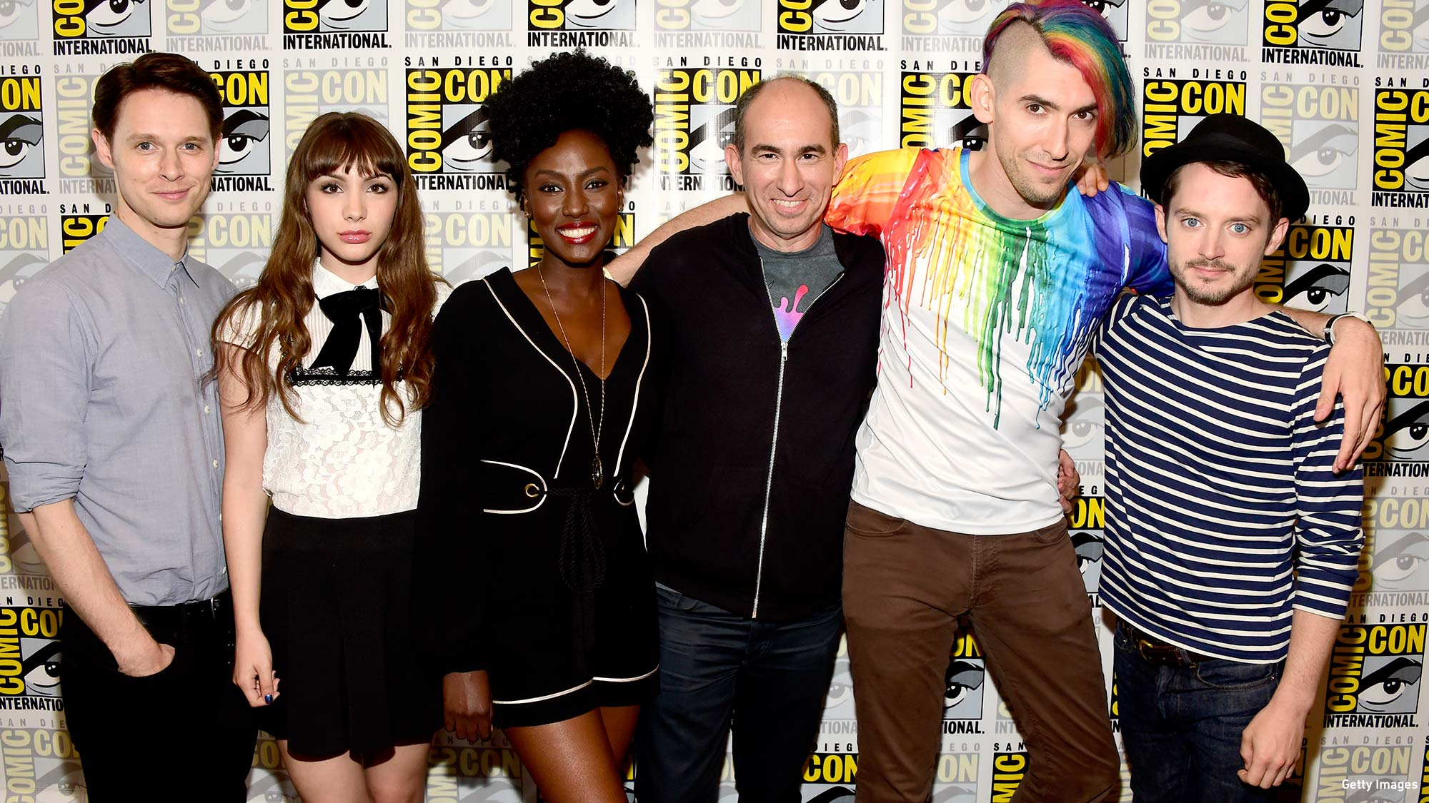 From left to right: Samuel Barnett, Hannah Marks, Jade Eshete, Showrunner Robert Cooper, Executive Producer Max Landis and Elijah Wood attend the 'Dirk Gently's Holistic Detective Agency' press line at San Diego Comic-Con 2016. (Photo: Frazer Harrison/Getty Images)