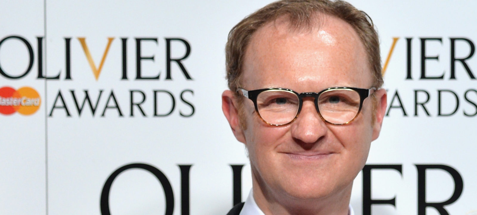 Mark Gatiss winner of the award for Best Actor in a Supporting Role for 'Three Days In The Country' and Judi Dench winner of the award for Best Actress in a Supporting Role for ' The Winter's Tale' pose in the winners room at The Olivier Awards at The Royal Opera House on April 3, 2016 in London, England.