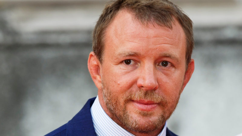 """Guy Ritchie and Jacqui Ainsley attend the people's premiere of """"The Man From U.N.C.L.E"""" during Film4 Summer Screenings at Somerset House on August 7, 2015 in London, England."""