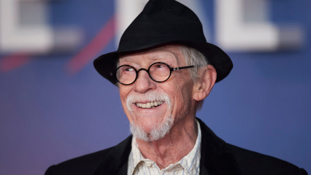 British actor John Hurt poses on arrival for the premiere of the film 'The Revenant' in London on January 14, 2016.