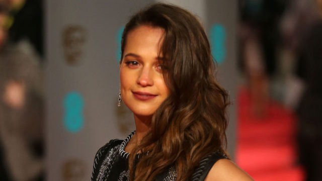 Swedish actress Alicia Vikander poses on arrival for the BAFTA British Academy Film Awards at the Royal Opera House in London on February 14, 2016.