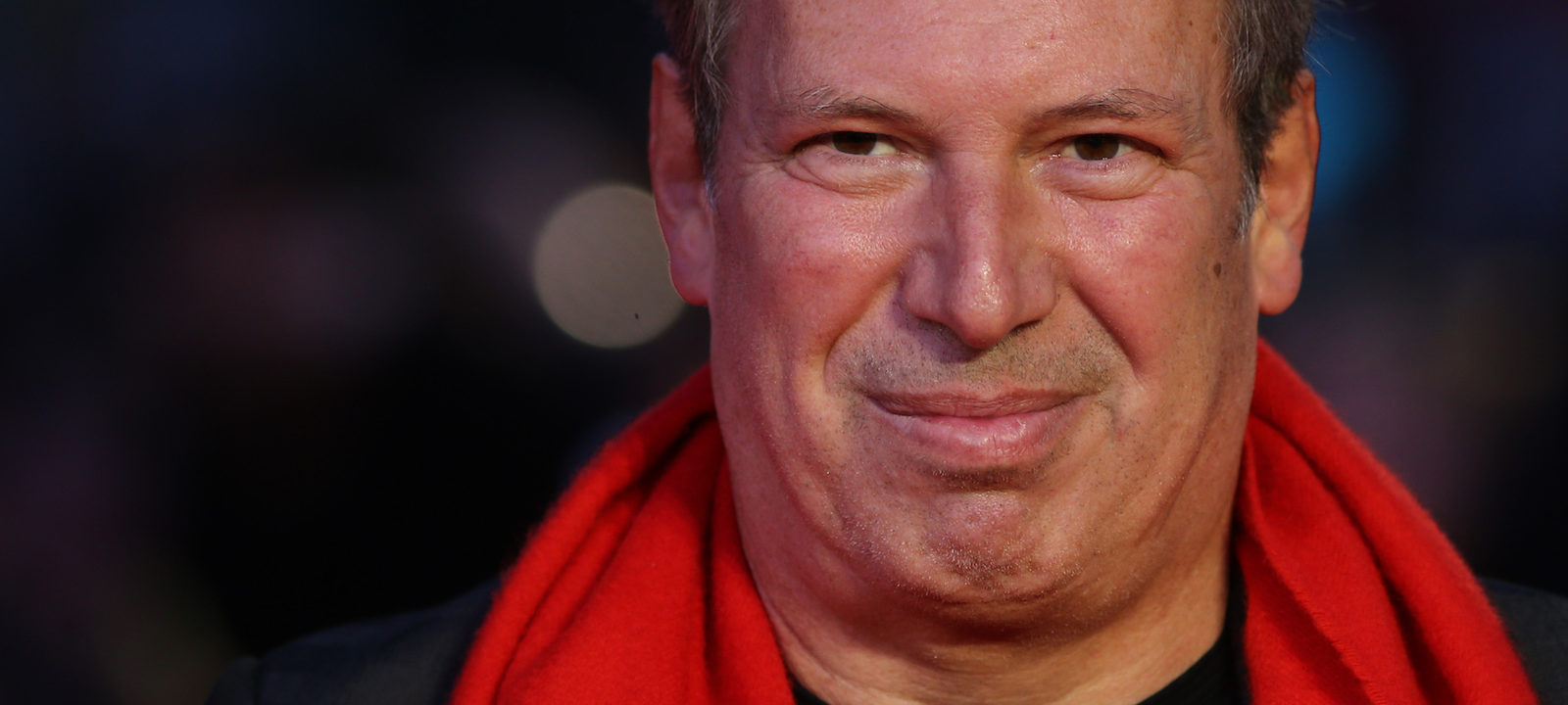 "German composer Hans Zimmer poses for a photograph after arriving to attend the European Premiere of the film ""Batman v Superman: Dawn of Justice"", in central London on March 22, 2016."