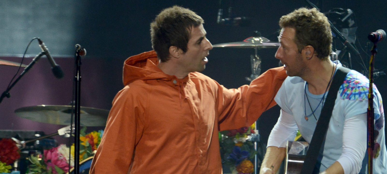 MANCHESTER, ENGLAND – JUNE 04:  NO SALES, free for editorial use. In this handout provided by 'One Love Manchester' benefit concert (L) Liam Gallagher and Chris Martin perform on stage on June 4, 2017 in Manchester, England. Donate at www.redcross.org.uk/love