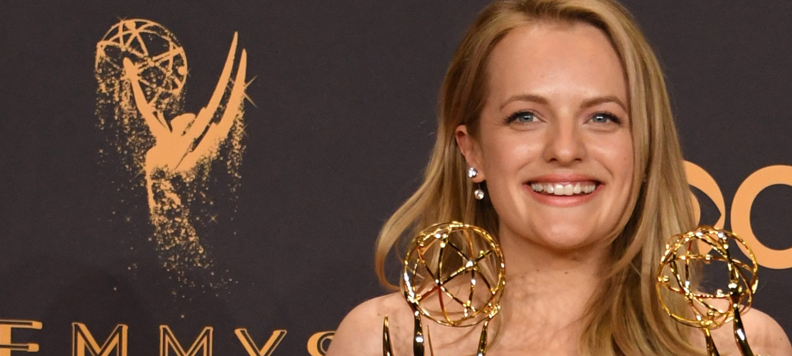 "Elisabeth Moss poses with the awards for  Outstanding Drama Series and Outstanding Lead Actress in a Drama Series for ""The Handmaid's Tale"" during the 69th Emmy Awards at the Microsoft Theatre on September 17, 2017 in Los Angeles, California"