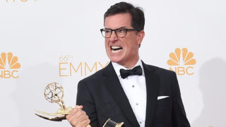 Writer/Producer/Host Stephen Colbert, winner of the for Outstanding Variety Series Award for The Colbert Report, poses in the press room during the 66th Annual Primetime Emmy Awards held at Nokia Theatre L.A. Live on August 25, 2014 in Los Angeles, California.