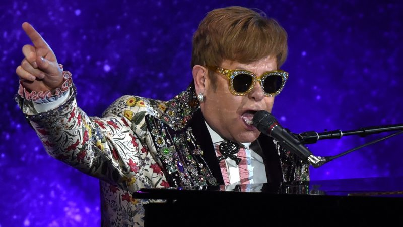 """Pop legend Elton John on Wednesday announced a final tour, saying he intends to stop traveling to spend more time with his family. The 70-year-old British entertainer, revealing his plans at a gala New York event, said he planned to """"go out with a bang"""" with a global tour that may last several years.  / AFP PHOTO / TIMOTHY A. CLARY"""
