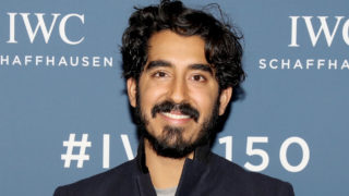 Dev Patel visits the IWC booth during the Maison's launch of its Jubilee Collection at the Salon International de la Haute Horlogerie (SIHH) on January 16, 2018 in Geneva, Switzerland. #IWC150
