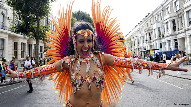 A performer joins in the celebrations during the Notting Hill Carnival in 2016. (Photo: Ben A. Pruchnie/Getty Images)