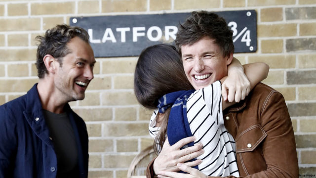 Eddie Redmayne (R) and Jude Law (L), stars of Fantastic Beasts: The Crimes Of Grindelwald, surprise fans at platform 9 3/4 during 'Back to Hogwarts' day celebration at Kings Cross Station on September 1, 2018 in London, England.
