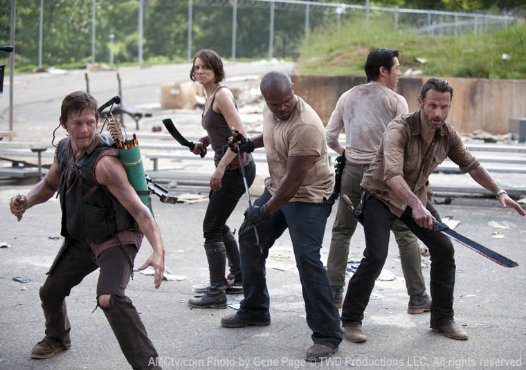 Daryl Dixon (Norman Reedus), Maggie Greene (Lauren Cohan), T-Dog (IronE Singleton), Glenn (Steven Yeun) and Rick Grimes (Andrew Lincoln) in Season 3 of The Walking Dead