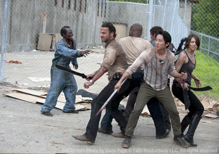 Rick Grimes (Andrew Lincoln), T-Dog (IronE Singleton), Daryl Dixon (Norman Reedus), Glenn (Steven Yeun) and Maggie Greene (Lauren Cohan) in Season 3 of The Walking Dead