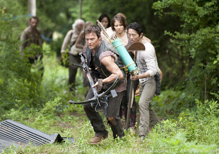 Daryl Dixon (Norman Reedus), Glenn (Steven Yeun), Maggie Greene (Lauren Cohan), Lori Grimes (Sarah Wayne Callies), Hershel Greene (Scott Wilson) and Rick Grimes (Andrew Lincoln) in Season 3 of The Walking Dead