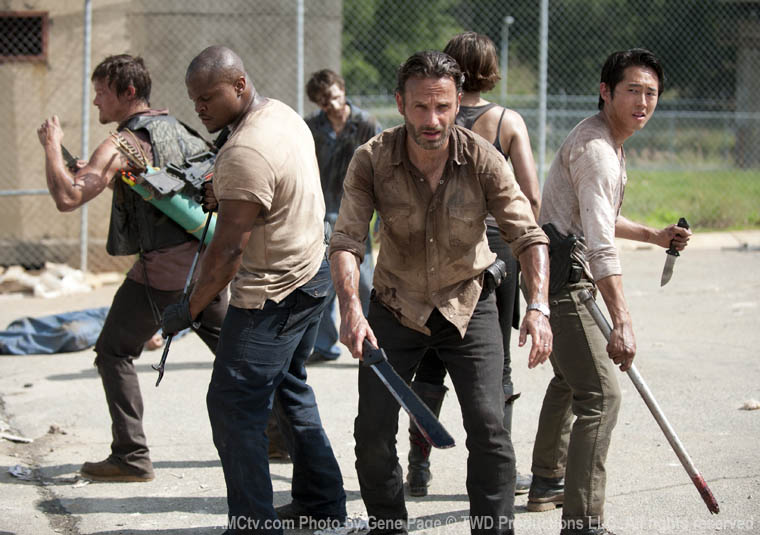 Daryl Dixon (Norman Reedus), T-Dog (IronE Singleton), Rick Grimes (Andrew Lincoln) and Glenn Rhee (Steven Yeun) in Episode 1 of The Walking Dead