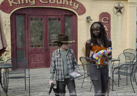 Carl Grimes (Chandler Riggs) and Michonne (Danai Gurira) in Episode 12 of The Walking Dead
