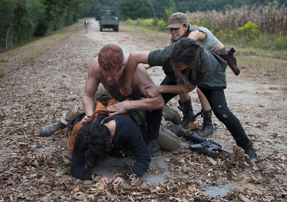 Glenn Rhee (Steven Yeun), Abraham Ford (Michael Cudlitz), Tara Chambler (Alanna Masterson) and Rosita Espinosa (Christian Serratos) in Episode 11 of The Walking Dead