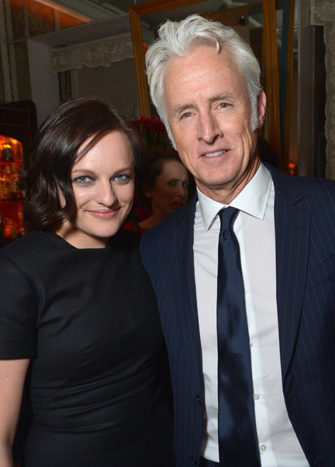 Elisabeth Moss (Peggy Olson) and John Slattery (Roger Sterling) of Mad Men