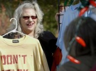 A local artist sells her recycled T-shirt designs to the folks tailgating at a taping of A Prairie Home Companion.