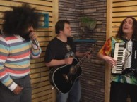 "Reggie Watts makes music with ""Weird Al"" Yankovic as Jack Black and Kyle Gass look on."