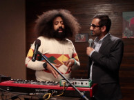 Reggie makes music with guest Aziz Ansari.