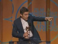 Ethan Hawke accepts the award for Best Director on Richard Linklater's behalf at the 2015 Independent Spirit Awards.