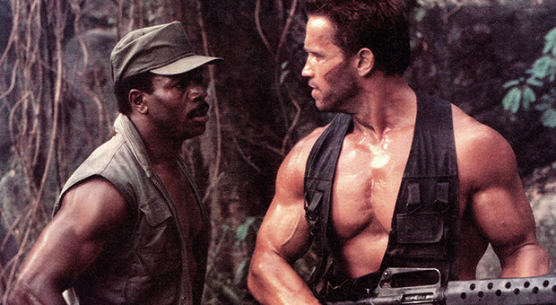 PREDATOR, from left: Carl Weathers, Arnold Schwarzenegger, 1987, TM & Copyright © 20th Century Fox F
