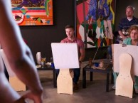 Gigi dominates the conversation at an art class.