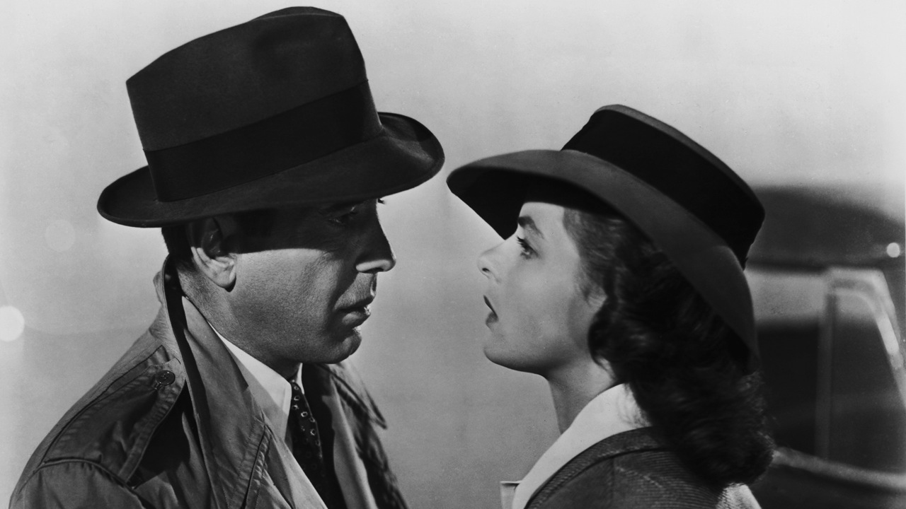 FILE – NOVEMBER 23, 2012:  The American romantic movie drama Casablanca celebrated its world premiere on November 26, 1942. Starring Humphrey Bogart and Ingrid Bergman the film was a solid success in its initial run, winning three Academy Awards, and its characters, dialogue, and music have become iconic. It now consistently ranks near the top of lists of the greatest films of all time.    Please refer to the following profile on Getty Images Archival for further imagery:    http://www.gettyimages.co.uk/Search/Search.aspx?EventId=113854183&EditorialProduct=Archival&esource=maplinARC_uki_12nov Humphrey Bogart (1899 - 1957) and Ingrid Bergman (1915 - 1982) star in the Warner Brothers film 'Casablanca', 1942. (Photo by Popperfoto/Getty Images)