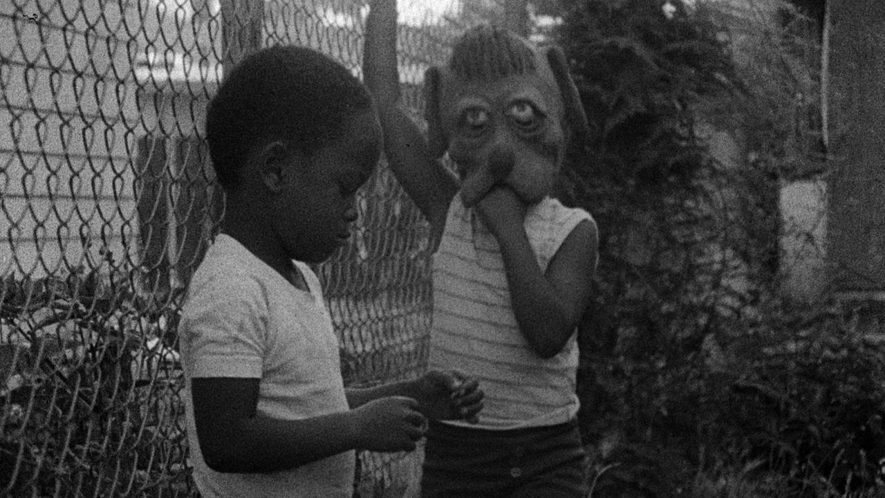 Angela (played by Angela Burnett) and neighborhood boy in the film KILLER OF SHEEP. Courtesy of Milestone Films.