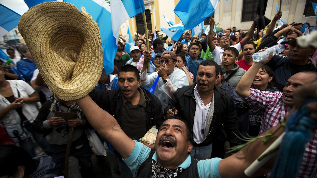 Protestors celebrate as they hear the news that Congress has voted to withdraw President Otto Perez Molina's immunity from prosecution in Guatemala City, Guatemala, on Tuesday, Sept. 1, 2015. Photo: Saul Martinez