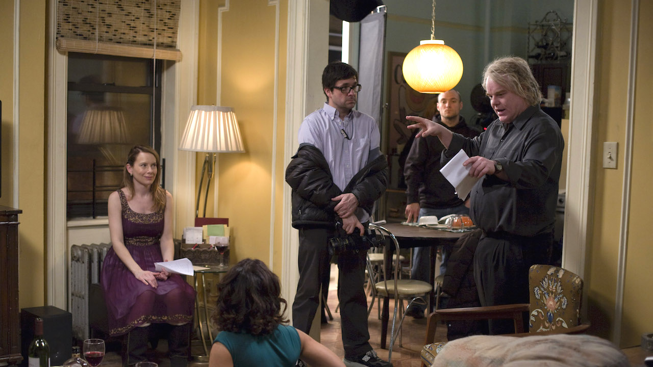 M 212-DF-02818  (Counterclockwise) Director and star Philip Seymour Hoffman discusses a scene with DP Mott Hupfel, stars Amy Ryan and Daphne Rubin-Vega on the set of Overture Films' Jack Goes Boating.